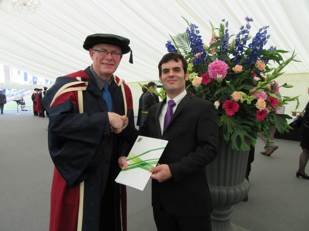 Dr Nigel Crook, Head of Department of Computing and Communication Technologies, presenting the award to